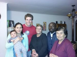 VINCENT BOAKYE WITH THE HOST FAMILY DURING A VISIT BY FELLOW VOLUNTEER